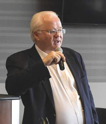 Michelle Davies   The Journal Gazette Minor League Baseball President Pat O'Conner speaks at Wednesday's Midwest League meeting.