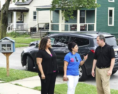 Jamie Duffy | The Journal Gazette  In this June 2017 photo, Denise Andorfer, executive director of Vincent Village, center, Dave Walters, director of The Chapel's Change Your World outreach and Heather Presley-Cowan discuss housing efforts on the southeast side.