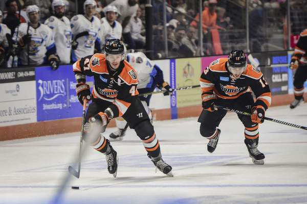 Mike Moore | The Journal Gazette Komets forward A.J. Jenks and forward Anthony Petruzzelli break away down the ice in the first period against Toledo at Memorial Coliseum on Saturday.