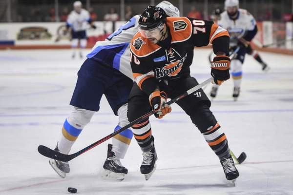 Mike Moore | The Journal Gazette Komets forward Shawn St-Amant gains position of the puck after colliding with a Toledo defender in the first period at Memorial Coliseum on Saturday.