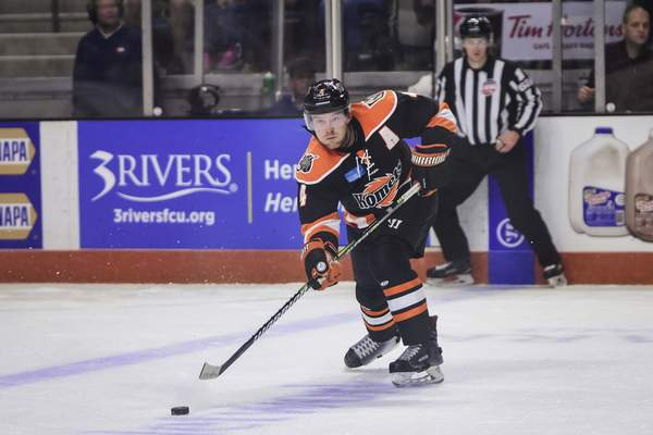 Mike Moore | The Journal Gazette Komets defenseman Jason Binkley passes the puck in the first period against Toledo at Memorial Coliseum on Saturday.