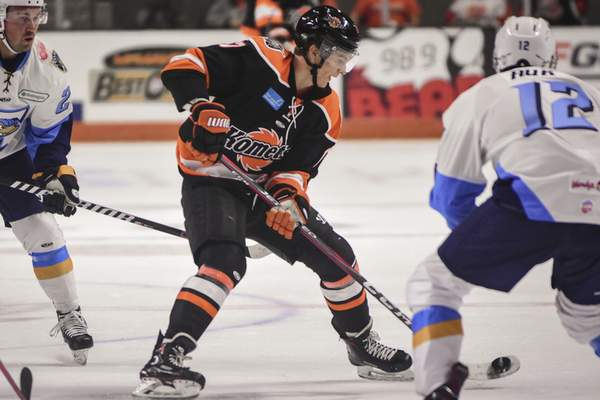 Mike Moore | The Journal Gazette Komets forward Brad Morrison controls the puck in the first period against Toledo at Memorial Coliseum on Saturday.