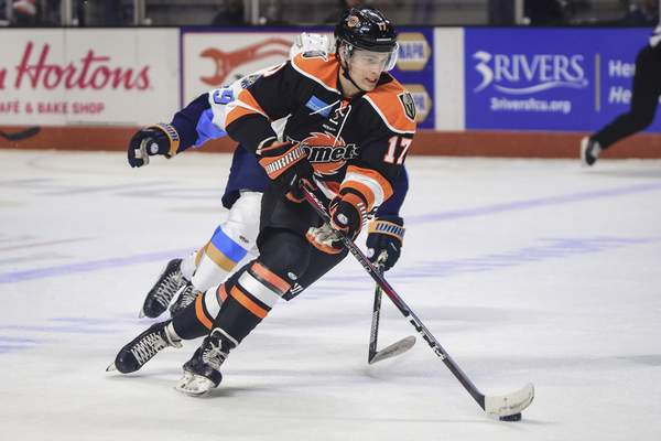 Mike Moore | The Journal Gazette Komets forward Brad Morrison controls the puck in the first period against Toledo at Memorial Coliseum on Saturday