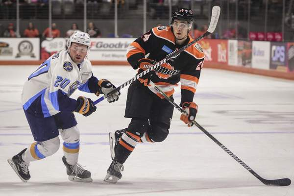 Mike Moore | The Journal Gazette  Komets defenseman Marc-Olivier Duquette passes the puck in the first period against Toledo at Memorial Coliseum on Saturday.