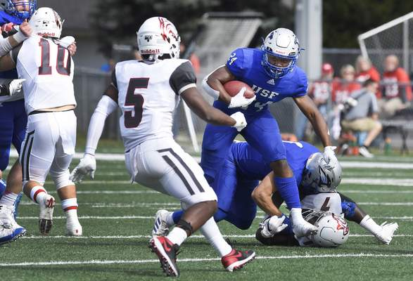 Rachel Von Stroup | The Journal Gazette Saint Francis' Martell Williams tries to find a clear opening to run the ball through during the second quarter against Indiana Wesleyan at the Bishop John D'Arcy Stadium on Saturday afternoon.