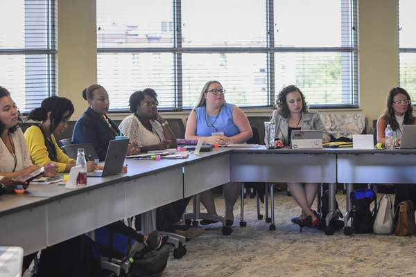Mike Moore | The Journal Gazette  Guests attend a presentation titled, It Starts With Your Story at Indiana Tech's Keene building during the AVOW Women's Campaign Institute in August.