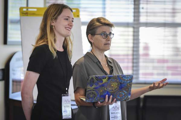 Mike Moore | The Journal Gazette  Sara Jane Rose, right, founder of Sally's List of Oklahoma and Alyssa Fisher, programs manager, give a presentation titled, It Starts With Your Story at Indiana Tech's Keene building for the AVOW Women's Campaign Institute in August.