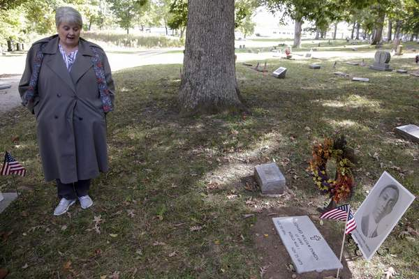 Associated Press Diana Vice, with the Daughters of the American Revolution, speaks next to a newly placed headstone  over Leonard  Inmon's grave Thursday in Lafayette. The World War I veteran was buried in an unmarked grave  in 1973.