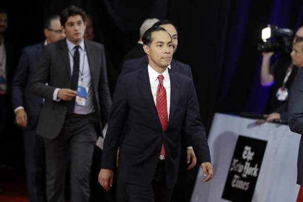 Democratic presidential candidate former Housing Secretary Julian Castro walks to be interviewed following a Democratic presidential primary debate hosted by CNN/New York Times at Otterbein University, Tuesday, Oct. 15, 2019, in Westerville, Ohio. (AP Photo/Tony Dejak)
