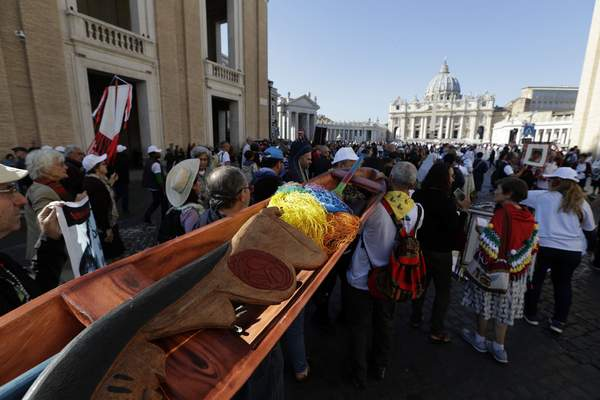 Members of Amazon indigenous populations walk during a Via Crucis (Way of the Cross) procession from St. Angelo Castle to the Vatican, Saturday, Oct. 19, 2019. (AP Photo/Andrew Medichini)