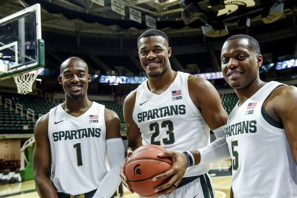 Associated Press Led by, from left, Joshua Langford, Xavier Tillman and Cassius Winston, Michigan State opens the season No. 1 in the AP Top 25.