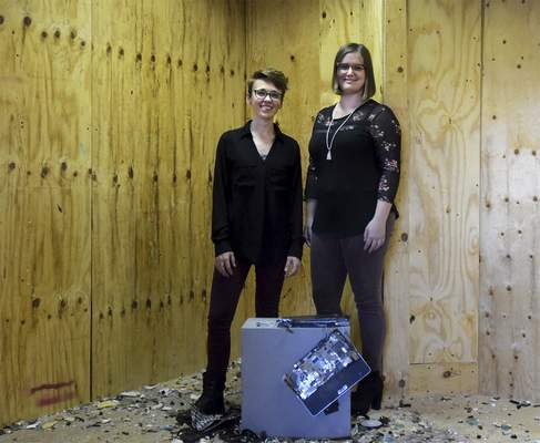 Katie Fyfe | The Journal Gazette  Co-owners of All the Rage Brianna Dailey (left) and Abby Greutman (right) together in one of the rage rooms at All the Rage at the corner of State and Spy Run on Monday, October 7th, 2019.