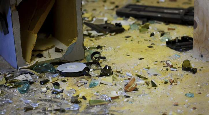 Katie Fyfe | The Journal Gazette  Shattered glass and broken items lie all over the ground of one of the rooms at All the Rage at the corner of State and Spy Run on Monday, October 7th, 2019.