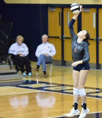 Elizabeth Wyman | The Journal Gazette  Sophie Krull serves the ball in Bellmont's 3-2 win over NorthWood in the Class 3A Norwell Regional Championship Saturday.