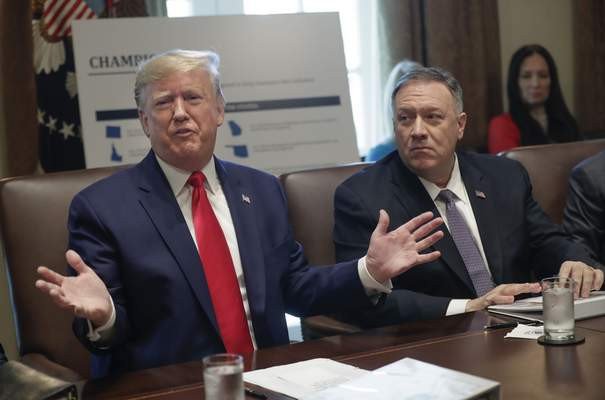 President Donald Trump, left, speaks during a Cabinet Meeting in the Cabinet Room of the White House, Monday, Oct. 21, 2019, in Washington, as Secretary of State Mike Pompeo listens. (AP Photo/Pablo Martinez Monsivais)