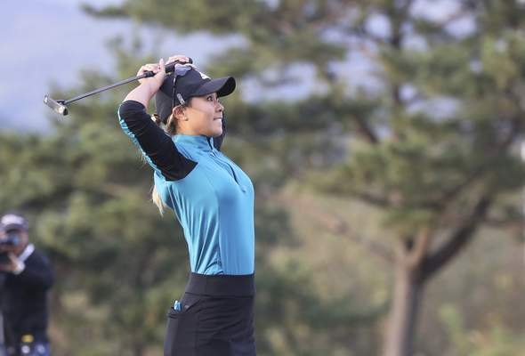 Danielle Kang of the United States reacts after missing a birdie putt during the LPGA's BMW Ladies Championship in the second playoff hole at LPGA International Busan in Busan, South Korea, Sunday, Oct. 27, 2019. (Jo Jong-ho/Yonhap via AP)