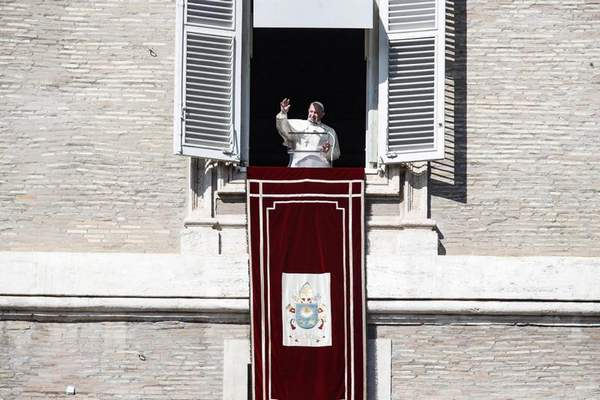 Pope Francis waves to faithful from his studio window overlooking St. Peter's Square, during the weekly Angelus prayer at the Vatican, Sunday, Oct. 27, 2019. (Giuseppe Lami/ANSA via AP)