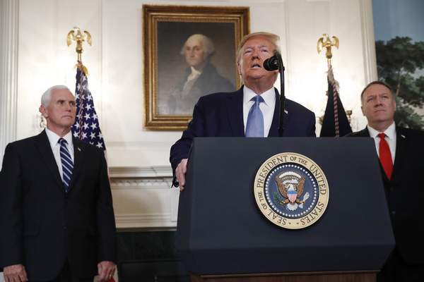 President Donald Trump, accompanied by Vice President Mike Pence, left, and Secretary of State Mike Pompeo, speaks Wednesday, Oct. 23, 2019, in the Diplomatic Room of the White House in Washington. (AP Photo/Jacquelyn Martin)