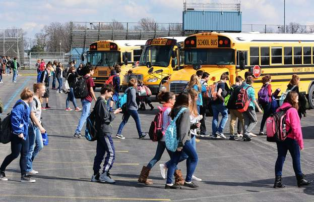 FILE: Carroll High School students board the Northwest Allen County Schools buses after school.