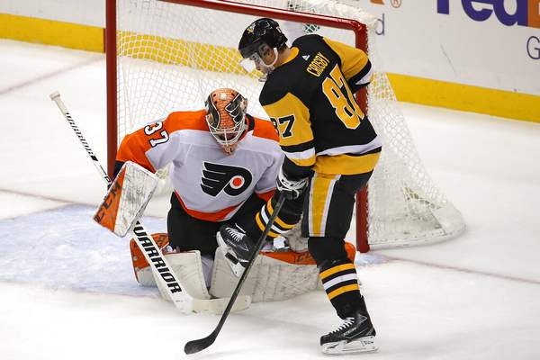 Gene J. Puskar | Associated Press Pittsburgh Penguins' Sidney Crosby (87) tries to get a shot off in front of Philadelphia Flyers goaltender Brian Elliott (37) during the first period of an NHL hockey game in Pittsburgh, Tuesday.