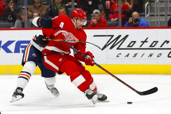 Associated Press Edmonton Oilers defenseman Ethan Bear (74) tries to stop Detroit Red Wings center Dylan Larkin (71) from shooting in the second period of an NHL hockey game, Tuesday in Detroit.