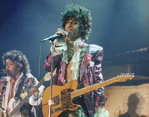 FILE - In this 1985 file photo, singer Prince performs in concert. The Revolution, the band that helped catapult Prince to international superstardom is reuniting in his memory. (AP Photo/File)