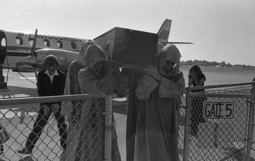 File photos A coffin containing Dracula is carried from a plane at Baer Field on Oct. 13, 1977, for a multiple sclerosis fundraiser.