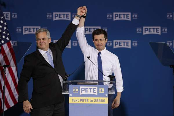 In this April 14, 2019, photo, Pete Buttigieg, right, is joined by Steve Adler, the mayor of Austin, Texas, as announces that he will seek the Democratic presidential nomination during a rally in South Bend, Ind. (AP Photo/Michael Conroy)