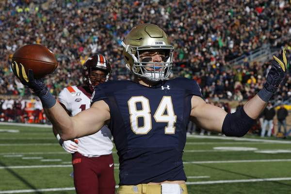 Notre Dame tight end Cole Kmet celebrates an 8-yard touchdown reception during Notre Dame's 21-20 win over Virginia Tech on Saturday. (AP Photo/Carlos Osorio)