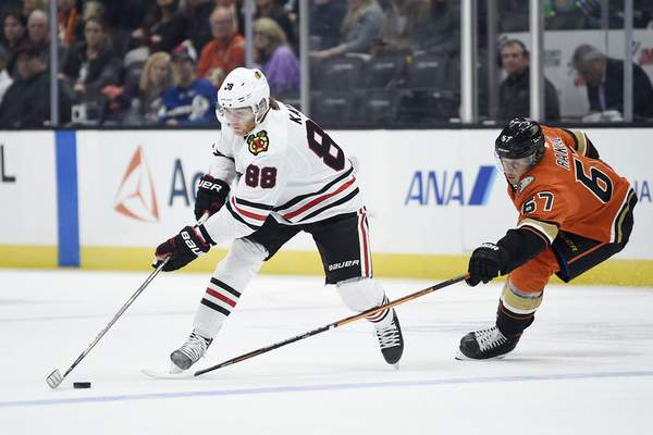 Chicago Blackhawks right wing Patrick Kane, left, moves the puck while Anaheim Ducks center Rickard Rakell defends during the first period of an NHL hockey game in Anaheim, Calif., Sunday, Nov. 3, 2019. (AP Photo/Kelvin Kuo)