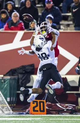 Indiana wide receiver Whop Philyor (1) tries to catch the ball as he's defended by Northwestern defensive back Cameron Ruiz (18) during the second half of an NCAA college football game, Saturday, Nov. 2, 2019, in Bloomington, Ind. Indiana won 34-3. (AP Photo/Doug McSchooler)