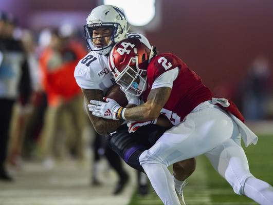 Northwestern wide receiver Ramaud Chiaokhiao-Bowman (81) is hit out-of-bounds by Indiana defensive back Reese Taylor (2) during the first half of an NCAA college football game, Saturday, Nov. 2, 2019, in Bloomington, Ind. (AP Photo/Doug McSchooler)