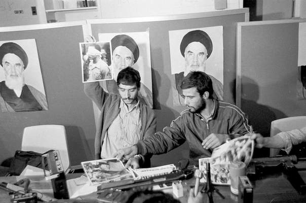 Associated Press In this Nov. 5, 1979, photo, Iranian student Ebrahim Asgharzadeh  holds up a portrait of one of the blindfolded hostages during a news conference in the U.S. Embassy in Tehran.