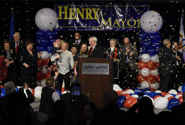 Mayor Tom Henry celebrates Tuesday at Grand Wayne Center after winning his fourth consecutive term, defeating Republican challenger Tim Smith. (Rachel Von Stroup | The Journal Gazette)