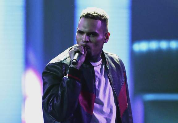 FILE - In this June 25, 2017, file photo, Chris Brown performs at the BET Awards at the Microsoft Theater in Los Angeles. (Photo by Matt Sayles/Invision/AP, File)