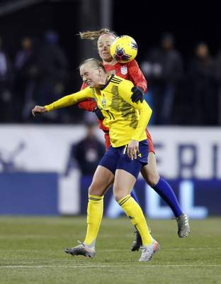 Sweden forward Stina Blackstenius, left, heads the ball in front of United States defender Becky Sauerbrunn during the first half of a women's international friendly soccer match in Columbus, Ohio, Thursday, Nov. 7, 2019. (AP Photo/Paul Vernon)
