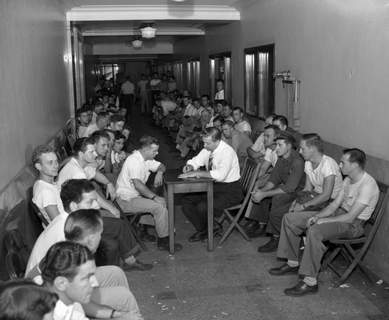 Aug. 20, 1948: The first group of 25-year-old await their turn to register for the draft. (Journal Gazette file photo)
