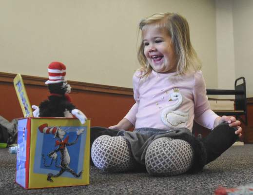 Michelle Davies   The Journal Gazette Paisley Hoffman, 2, is delighted by a jack-in-the-box Thursday morning during open play at the Shawnee branch of the Allen County Public Library.