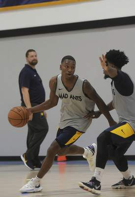 Katie Fyfe | The Journal Gazette Demetrius Denzel-Dyson, left, is back for his second season with the Mad Ants.