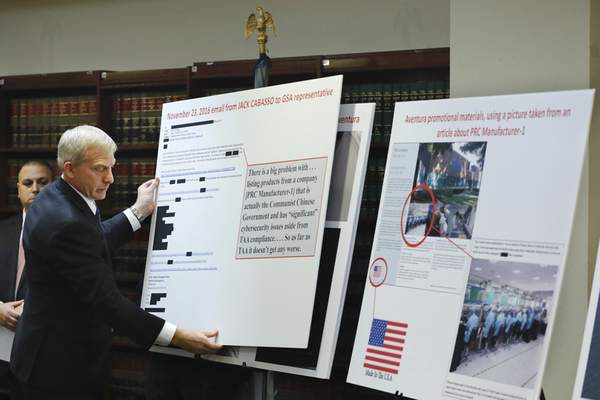 Associated Press U.S. Attorney Richard P. Donoghue announces charges against Aventura Technologies on Thursday in New York. The company has been charged with illegally importing and selling Chinese-made surveillance and security equipment to U.S. government agencies and private customers.