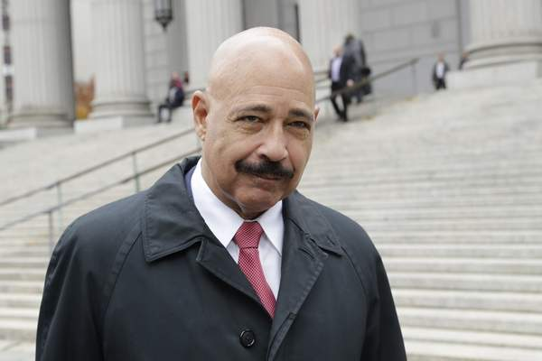 Associated Press Ted Wells Jr., the lead attorney for Exxon, leaves Manhattan Supreme Court on Thursday in New York.