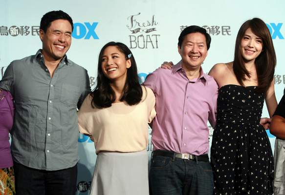 """FILE - In this Aug. 5, 2016 file photo, Randall Park, from left, Constance Wu, Ken Jeong and Ann Hsu pose for photographers during a media event announcing their comedy series Fresh off the Boat in Taipei, Taiwan. ABC's """"Fresh Off the Boat"""" is coming to an end after six seasons. The network said Friday, Nov. 8, 2019, the comedy about an Asian American family in the 1990s will wrap with an hour-long finale. The last episode will air Feb. 21. (AP Photo/Chiang Ying-ying, File"""