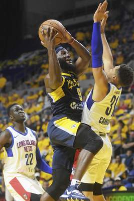 Katie Fyfe | The Journal Gazette  The Mad Ants' Ike Nwamu goes up for a shot during the fourth quarter against the Long Island Nets at Memorial Coliseum on Saturday.