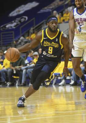 Katie Fyfe | The Journal Gazette  The Mad Ants' Ike Nwamu looks for a path to the basket during the third quarter against the Long Island Nets at Memorial Coliseum on Saturday.