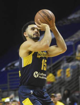 Katie Fyfe | The Journal Gazette  The Mad Ants' Naz Mitrou-Long shoots the ball during the fourth quarter against the Long Island Nets at Memorial Coliseum on Saturday.