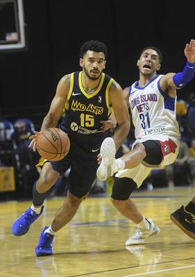 Katie Fyfe | The Journal Gazette  The Mad Ants' Naz Mitrou-Long makes a playwhile the Long Island Nets' Devin Cannady tries to defend him during the third quarter at Memorial Coliseum on Saturday.