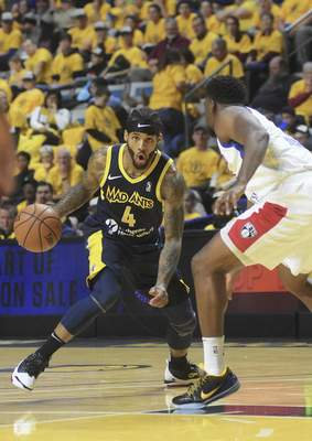 Katie Fyfe | The Journal Gazette  The Mad Ants' Walt Lemon Jr. looks to make a move during the third quarter against the Long Island Nets at Memorial Coliseum on Saturday.
