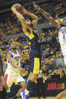 Katie Fyfe | The Journal Gazette  The Mad Ants' Naz Mitrou-Long drives to the basket during the fourth quarter against the Long Island Nets at Memorial Coliseum on Saturday.