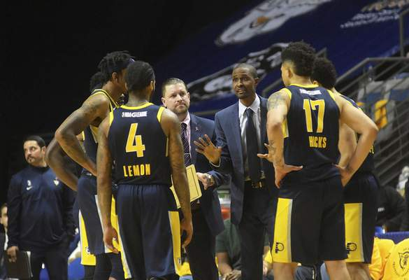 Katie Fyfe | The Journal Gazette Mad Ants' coaches Steve Gansey and Norm Richardson call a time out with thirty seconds left in the fourth quarter against the Long Island Nets at Memorial Coliseum on Saturday.