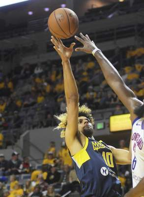 Katie Fyfe | The Journal Gazette  The Mad Ants' Brian Bowen II takes a shot during the fourth quarter against the Long Island Nets at Memorial Coliseum on Saturday.